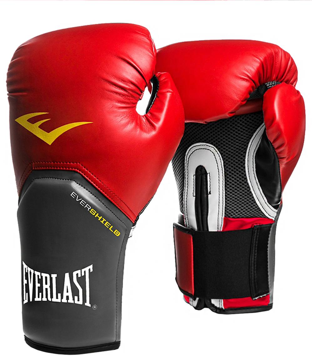 Перчатки боксерские Everlast Pro Style Elite, цвет: красный, 10 oz. 2110EУТ-00007014Перчатки боксерские Pro Style Elite - это тренировочные боксерские перчатки для спаррингов и работы на снарядах. Изготовлены из качественной искусственной кожи с применением технологий Everlast, использующихся в экипировке профессиональных спортсменов. Благодаря выверенной анатомической форме перчатки надежно фиксируют руку и гарантируют защиту от травм. Нижняя часть, полностью изготовленная из сетчатого материала, обеспечивает циркуляцию воздуха и препятствует образованию влаги, а также неприятного запаха за счет антибактериальной пропитки Everfresh.Комбинация легких дышащих материалов поддерживает оптимальную температуру тела.Модель подходит для начинающих боксеров, которые хотят тренироваться с экипировкой высокого класса.