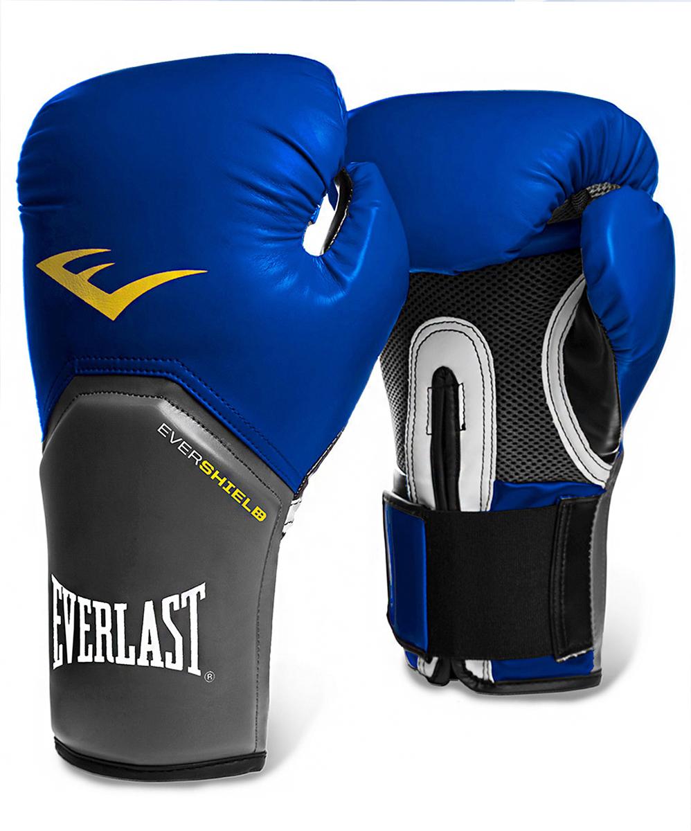 Перчатки боксерские Everlast Pro Style Elite, цвет: синий, 12 oz. 2212EУТ-00008579Перчатки боксерские Pro Style Elite - это тренировочные боксерские перчатки для спаррингов и работы на снарядах. Изготовлены из качественной искусственной кожи с применением технологий Everlast, использующихся в экипировке профессиональных спортсменов. Благодаря выверенной анатомической форме перчатки надежно фиксируют руку и гарантируют защиту от травм. Нижняя часть, полностью изготовленная из сетчатого материала, обеспечивает циркуляцию воздуха и препятствует образованию влаги, а также неприятного запаха за счет антибактериальной пропитки Everfresh.Комбинация легких дышащих материалов поддерживает оптимальную температуру тела.Модель подходит для начинающих боксеров, которые хотят тренироваться с экипировкой высокого класса.