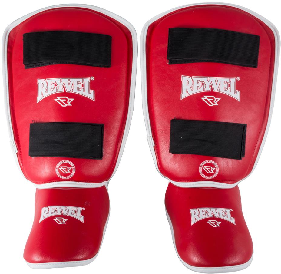 Защита голени Reyvel RV- 511, цвет: красный. УТ-00008903. Размер MУТ-00008903Защита голеностопа используется спортсменами во время спаррингов или тренировок в тех контактных единоборствах, где разрешены удары ногами.Это комплексное решение для защиты голени и ступни. Позволяет минимизировать риск получения травмы, смягчить удары. Защита голеностопа изготовлена из высококачественной винилискожи, внутренний наполнитель пенополиуретан.Надежно фиксируется на ноге с помощью эластичной текстильной ленты и застежки-липучки велкро. Нескользящая подкладка позволяет бойцу чувствовать себя комфортно и уверенно работать в полную силу. Дополнительную защиту обеспечивает специальное утолщение в районе большеберцовой кости и накладка на подъем стопы.