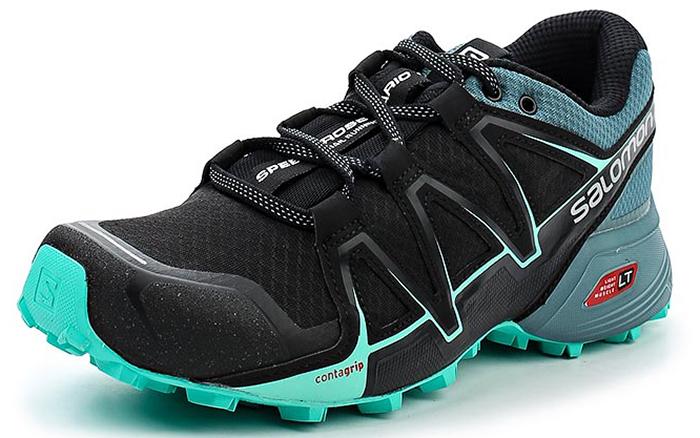 Кроссовки для бега женские Salomon Speedcross Vario 2 W, цвет: черный, серый. L39841800. Размер 8 (40,5)L39841800SPEEDCROSS VARIO 2 для женщин — это настоящий монстр на тропе, которого вам, возможно, удастся приручить. Созданные на базе легендарной модели Speedcross, кроссовки Vario имеют менее агрессивный рисунок протектора, дренажные канавки и классическую шнуровку, обеспечивая точность, сцепление и комфорт на мягкой и твердой земле.