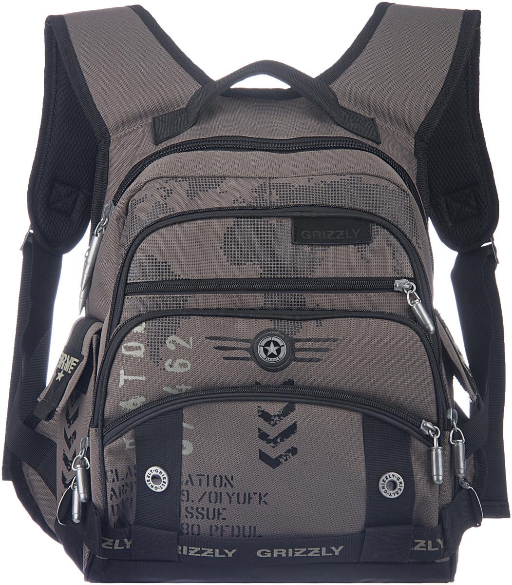 Рюкзак молодежный мужской Grizzly, цвет: черный, серый, 18,5 л. RU-501-2/2RU-501-2/2Рюкзак с жесткой анатомической спинкой Grizzly изготовлен из полиэстера и имеет два отделения, карман на молнии на передней стенке, боковые карманы с клапанами на липучках, внутренний карман-пенал для карандашей, жесткая анатомическая спинка, карман быстрого доступа в передней части рюкзака. Рюкзак оснащен двумя широкими мягкими лямками регулируемой длины и удобной короткой ручкой.