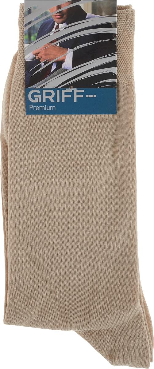 Носки мужские Griff Premium, цвет: бежевый. E1. Размер 42/44E1Мужские носки Griff Premium изготовлены из высококачественного сырья с добавлением полиамидных волокон, которые обеспечивают великолепную посадку. Носки отличаются элегантным внешним видом. Удобная широкая резинка идеально облегает ногу и не пережимает сосуды, усиленные пятка и мысок повышают износоустойчивость носка, а удлиненный паголенок придает более эстетичный вид.