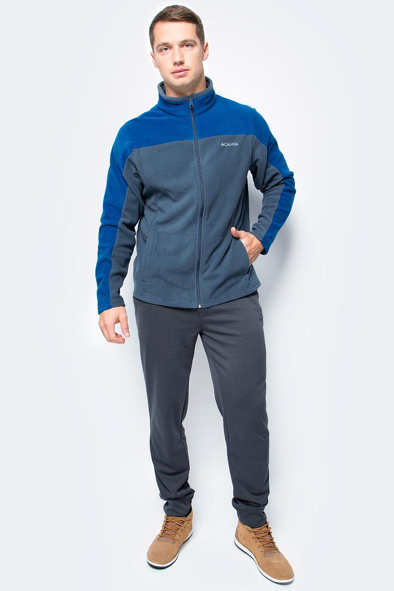 Толстовка мужская Columbia Western Ridge Full Zip M, цвет: темно-синий, серый. 1736711-436. Размер XXL (56/58)1736711-436Классическая мужская флисовая толстовка от Columbia на молнии для использования в качестве среднего слоя одежды. Флис - это очень удачный материал для одежды, которая направлена на удержание тепла, ведь ткань даже в мокром состоянии сохраняет свои теплоизоляционные свойства. Воротник-стойка защитит шею от продувания ветром. Модель дополнена двумя боковыми карманами и оформлена на груди логотипом с названием бренда.