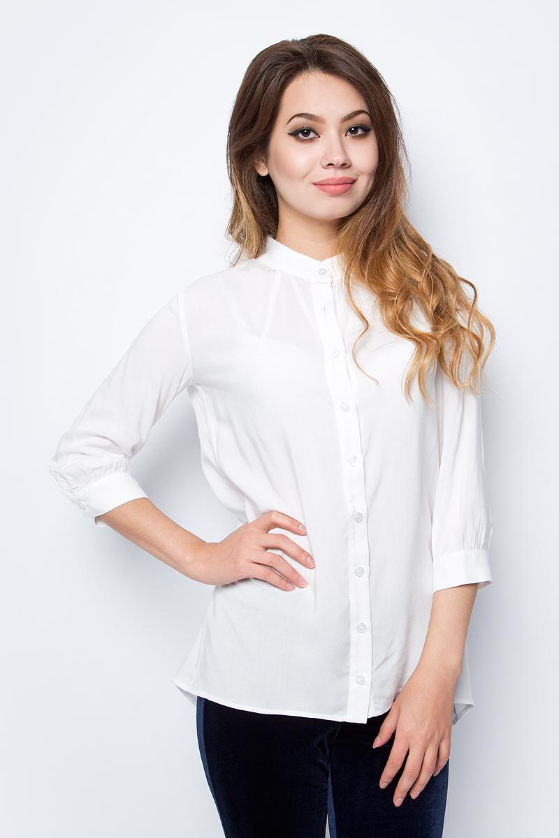 Блузка женская La Via Estelar, цвет: белый. 33946. Размер 4233946Лаконичная блузка La Via Estelar выполнена из хлопка с добавлением вискозы. Модель с удлиненной спинкой и рукавами 3/4 спереди застегивается на пуговицы. Такая блузка займет достойное место в вашем гардеробе.
