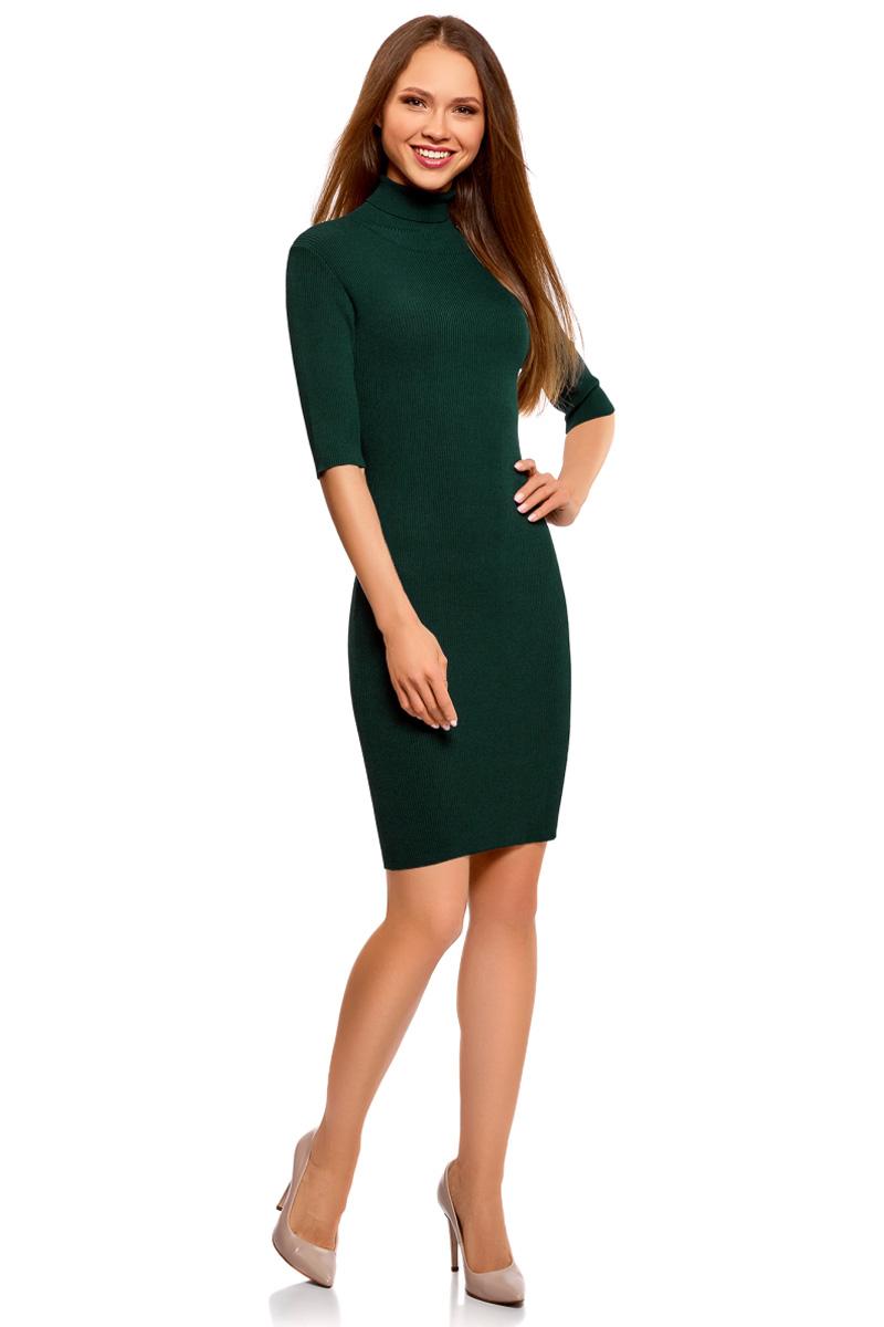 Платье oodji Ultra, цвет: темно-изумрудный. 63912225/46999/6E00N. Размер XXS (40)63912225/46999/6E00NВязаное платье от oodji выполнено из вискозной пряжи. Модель приталенного кроя с рукавами до локтя и воротником-гольф на спине дополнено вырезом-капелькой.