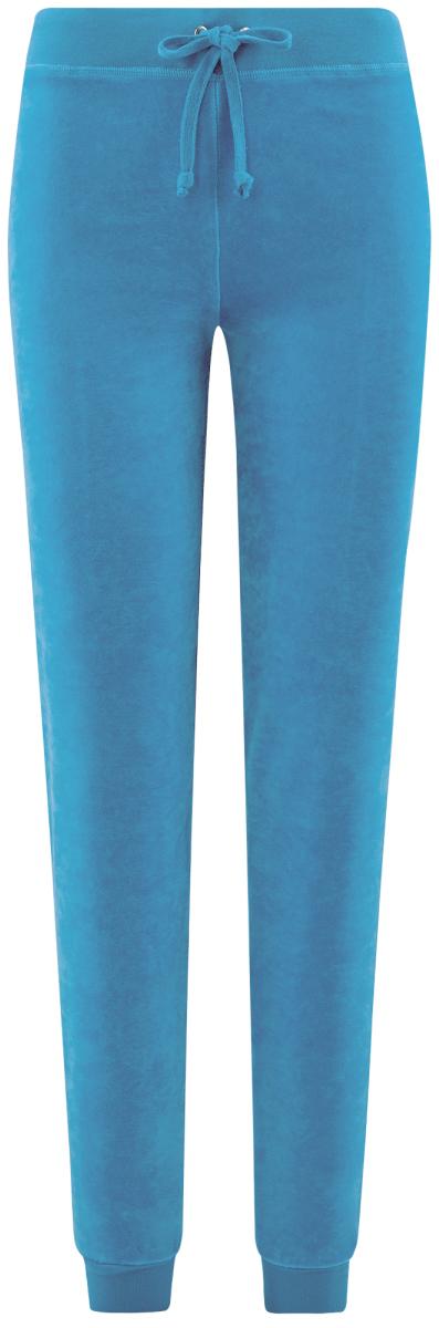 Брюки спортивные женские oodji Ultra, цвет: синий. 16701051B/47883/7502N. Размер M (46)16701051B/47883/7502NЖенские спортивные брюки oodji изготовлены из качественной смесовой ткани. Модель выполнена с широким эластичным поясом на талии и с завязками. Низы брючин дополнены широкими манжетами.