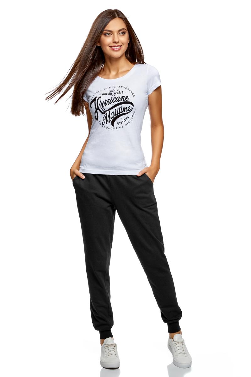 Брюки спортивные женские oodji Ultra, цвет: черный. 16701042-1B/46919/2900N. Размер XS (42)16701042-1B/46919/2900NЖенские спортивные брюки oodji Ultra, выполненные из натурального хлопка, великолепно подойдут для отдыха и занятий спортом. Модель дополнена широкими эластичными резинками на поясе и по низу брючин. Объем талии регулируется с внешней стороны при помощи шнурка-кулиски. Спереди имеются два втачных кармана.