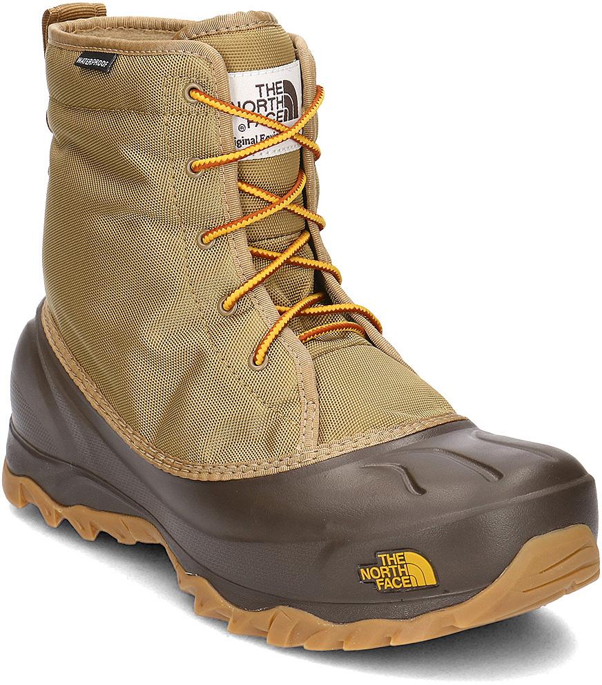 Ботинки мужские The North Face M Tsumoru Boot Utility, цвет: коричневый, желтый. T93MKSA5J. Размер 11H (45)T93MKSA5JМужские водонепроницаемые ботинки Tsumoru Boot Utility от The North Face с мягкой подкладкой из флиса. Гарантированно сохранят ноги в сухости во время зимних приключений. Мембрана HydroSeal защитит ваши ноги от замерзающих луж, в то время как материал PrimaLoft Silver Insulation Eco надежно сохранит тепло ног. Прочная резиновая подошва TNF Winter Grip обеспечивает надежное сцепление с непредсказуемой зимней поверхностью.