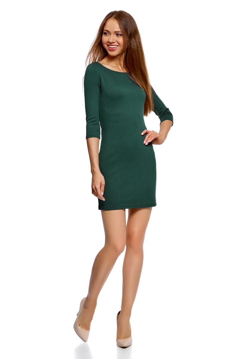 Платье oodji Ultra, цвет: темно-изумрудный. 14001071/47093/6E00N. Размер XL (50)14001071/47093/6E00NТрикотажное платье от oodji выполнено из эластичного трикотажа. Модель облегающего кроя с рукавами 3/4 и круглым вырезом горловины.