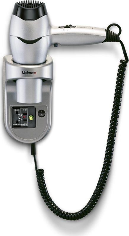 Valera Excel 1600 Shaver, Silver фен561.17/032.04LНастенный фен Valera Excel 1600 Shaver классической формы - это превосходный аксессуар для дома, гостиницы или фитнес клуба. Фен оснащен режимом подачи холодного воздуха. Режимы работы меняются при помощи ползункового переключателя. Имеется 2 ступени скорости воздушного потока и 3 уровня температуры воздушного потока. Безопасная кнопка включения/выключения на фене обеспечит подачу воздуха только при нажатии. Настенный держатель c включателем/выключателем и розеткой для подключения других электроприборов. Воздушный фильтр съемный.