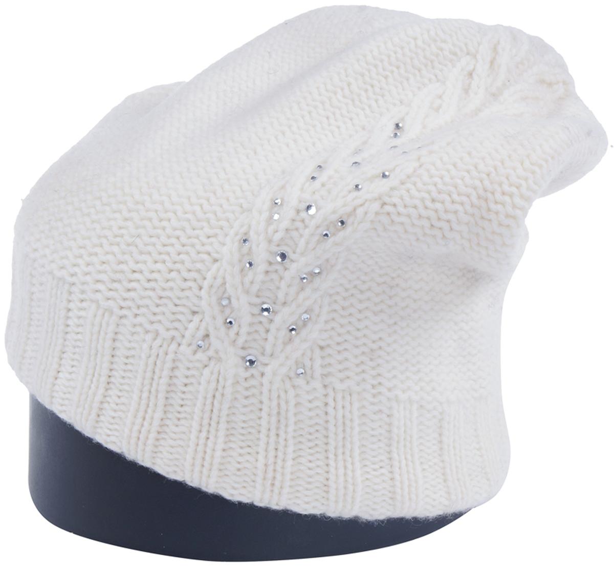 Шапка женская Vittorio Richi, цвет: белый. Aut241757N-11/17. Размер 56/58Aut241757NСтильная женская шапка Vittorio Richi отлично дополнит ваш образ в холодную погоду. Модель, изготовленная из шерсти с добавлением полиамида, максимально сохраняет тепло и обеспечивает удобную посадку. Шапка дополнена ажурной вязкой и сбоку стразами. Привлекательная стильная шапка подчеркнет ваш неповторимый стиль и индивидуальность.