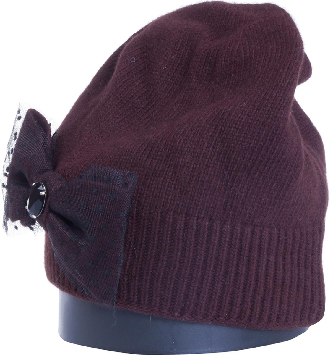 Шапка женская Vittorio Richi, цвет: коричневый. Aut361881L-85/17. Размер 56/58Aut361881LСтильная женская шапка Vittorio Richi отлично дополнит ваш образ в холодную погоду. Модель, изготовленная из высококачественных материалов, максимально сохраняет тепло и обеспечивает удобную посадку. Шапка дополнена сбоку декоративным бантом. Привлекательная стильная шапка подчеркнет ваш неповторимый стиль и индивидуальность.