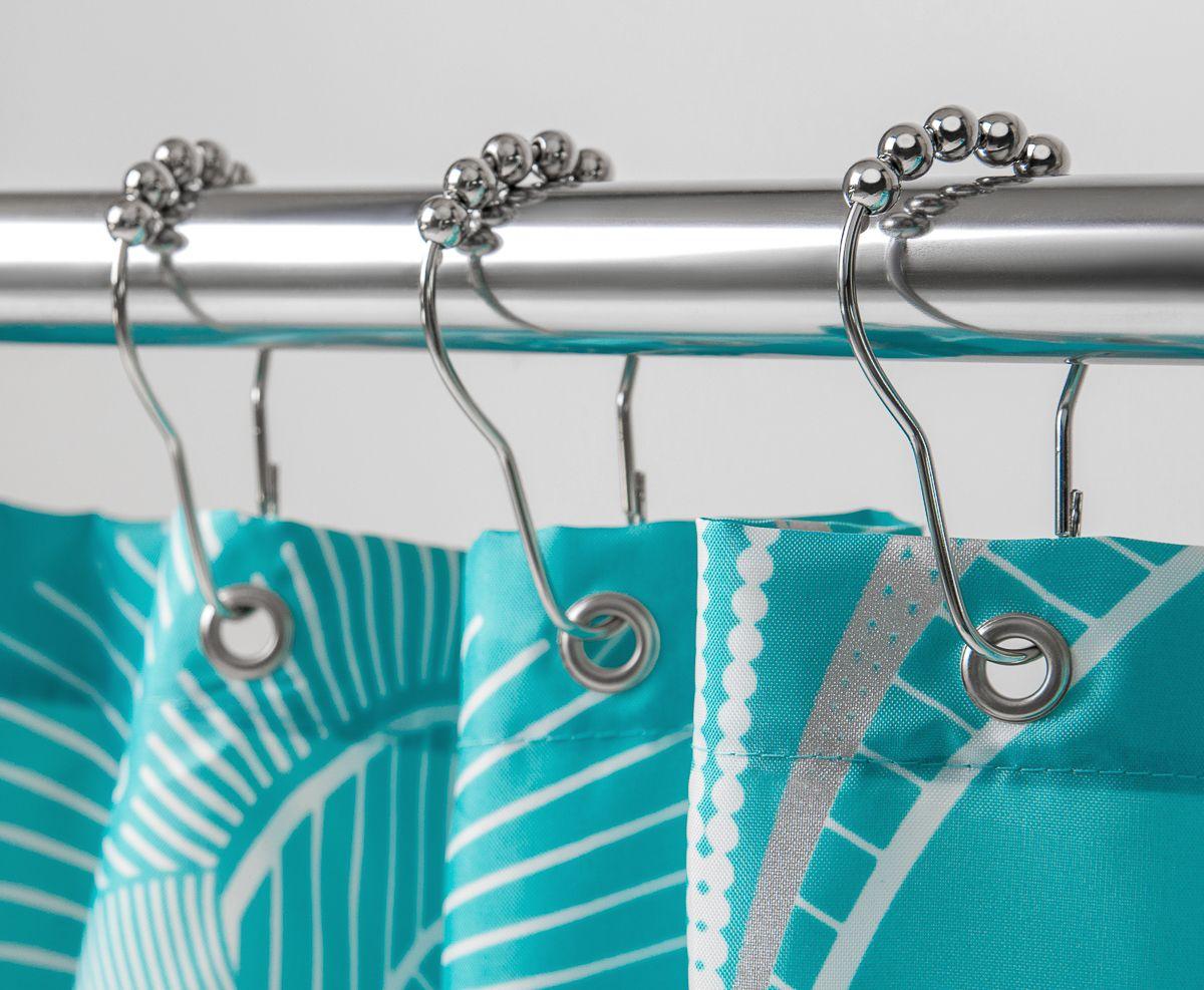 Оригинальный дизайн металлических колец позволит гармонично продолжить дизайн шторы и задать единое звучание интерьеру ванной комнаты. Благодаря продуманной системе крепежа кольца позволяют легко и быстро снимать и вешать занавеску без демонтажа карниза. В упаковке 12 колец.