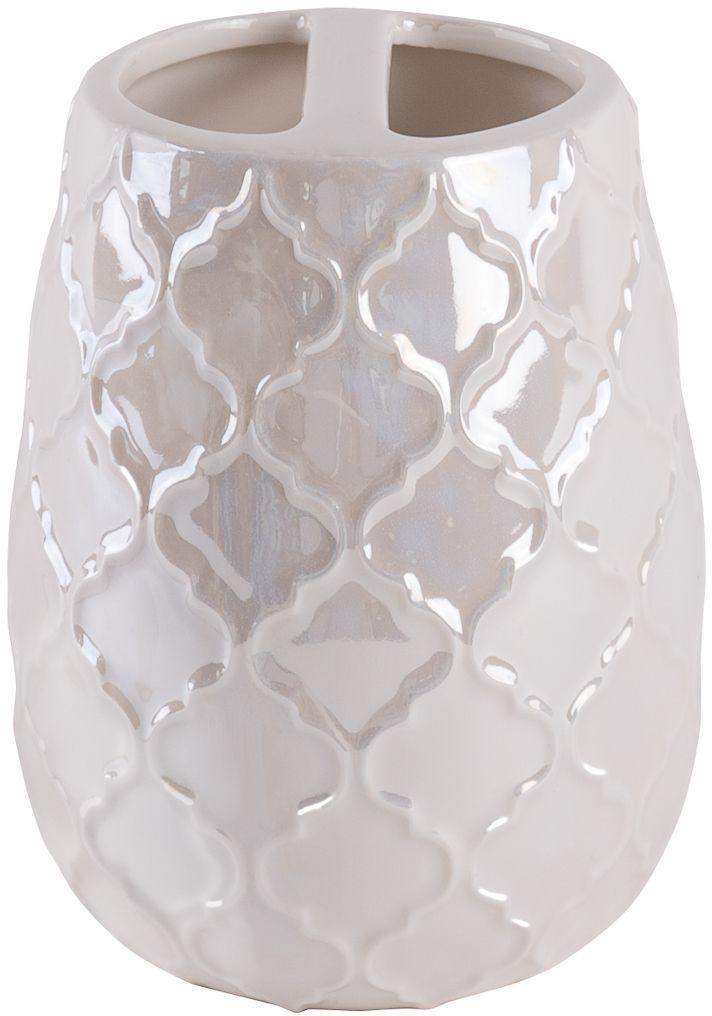 Стакан для зубных щеток Wess Lamis, с разделителем, цвет: бежевый. G86-89G86-89Орнамент на предмете - марокканский четырехлистник. Это традиционный и очень узнаваемый рисунок восточной культуры. В интерьере кроме восточного стиля коллекция подойдет к стилю эклектики, колониальному и классическому стилю. Перламутровый цвет спокойный и нейтральный, что дает возможность сочетания с огромной палитрой цветов.