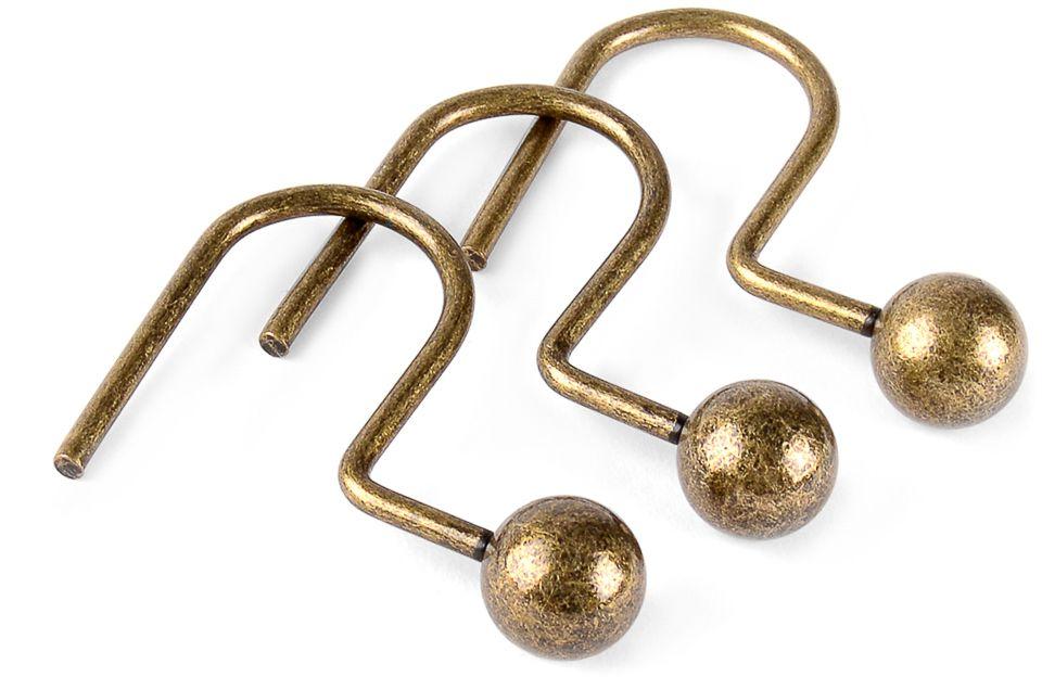 """Фирменные кольца """"Moroshka"""" изготовлены из металла с покрытием золотого цвета. Декоративные элементы с тематическим рисунком выполнены из керамики.  Кольца просты в установке: продеваются через люверс на занавеске и цепляются за карниз.  В упаковке 12 штук."""