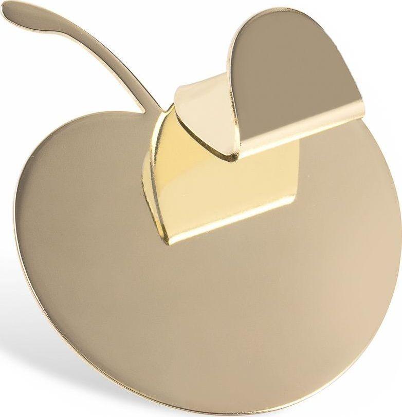 Крючок из литого куска металла в форме яблока. Покрыт краской цвета золота. Крепится на ровную поверхность при помощи стикера на обратной стороне изделия. Использовать стикер можно только раз. Максимальная нагрузка - 5 кг.