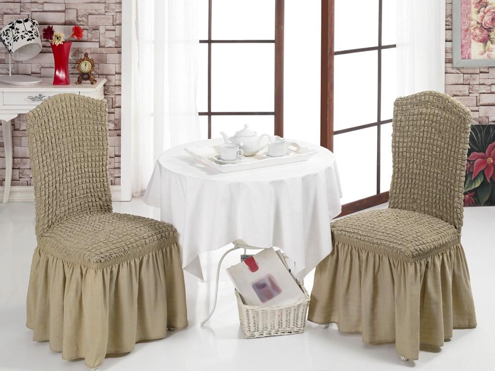 Набор чехлов для стульев Karna Bulsan, цвет: бежевый, 2 шт1906/CHAR002Набор Karna Bulsan состоит из двух универсальных чехлов для стульев, изготовленных из высококачественного материала на основе полиэстера и хлопка и дополненных широкой юбкой, скрывающей низ мебели.Изделия оснащены фиксаторами, которые позволяют надежно закрепить чехол на мебели. Фиксаторы вставляются в расстояние между спинкой и сиденьем, фиксируя чехол в одном положении, и не позволяя ему съезжать и терять форму. Фиксаторы особенно необходимы в том случае, если у вас кожаная мебель или мебель нестандартных габаритов.Характеристики: Плотность: 360 гр/м2.Ширина и длина посадочного места: 35+30 см. Высота спинки от посадочного места: 50+30 см. Ширина спинки: 35+30 см. Высота юбки: 35 см.
