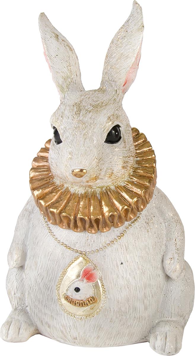 Фигурка декоративная Magic Home Кролик, цвет: слоновая кость, золотой, 15 х 13,2 х 21,5 см76660Фигурка декоративная Кролик - это прекрасное украшение интерьера, выполненное из высококачественной полирезины. Это простой и доступный способ сделать неповторимым свой интерьер, как дома, так и в офисе. Сказочный персонаж создает атмосферу волшебства и радости, которая увлечёт за собой детей и взрослых. Изумительная фигурка станет отличным подарком для близких и друзей, вызывая улыбку и поднимая настроение с первого взгляда. В коллекции ЧУДЕСНАЯ СТРАНА представлено несколько обаятельных и задорных героев, которые покоряют своей оригинальностью.