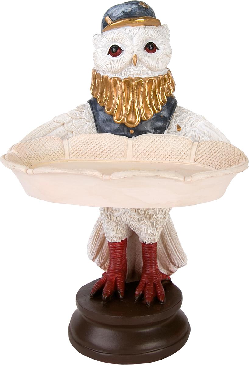 Фигурка декоративная Magic Home Сова с подносом, высота 18 см76664Фигурка декоративная Сова с подносом - это прекрасное украшение интерьера, выполненное из высококачественной полирезины. Это простой и доступный способ сделать неповторимым свой интерьер, как дома, так и в офисе. Сказочный персонаж создает атмосферу волшебства и радости, которая увлечёт за собой детей и взрослых. Изумительная фигурка станет отличным подарком для близких и друзей, вызывая улыбку и поднимая настроение с первого взгляда. В коллекции ЧУДЕСНАЯ СТРАНА представлено несколько обаятельных и задорных героев, которые покоряют своей оригинальностью.