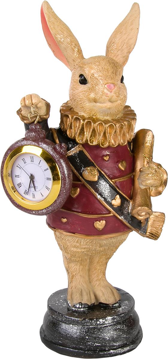 Фигурка декоративная Magic Home Кролик с часами и свитком, 11 х 8,5 х 21 см76669Фигурка декоративная Кролик с часами и свитком с кварцевыми часами - это прекрасное украшение интерьера, выполненное из высококачественной полирезины. Это простой и доступный способ сделать неповторимым свой интерьер, как дома, так и в офисе. Сказочный персонаж создает атмосферу волшебства и радости, которая увлечёт за собой детей и взрослых. Изумительная фигурка станет отличным подарком для близких и друзей, вызывая улыбку и поднимая настроение с первого взгляда. В коллекции ЧУДЕСНАЯ СТРАНА представлено несколько обаятельных и задорных героев, которые покоряют своей оригинальностью.