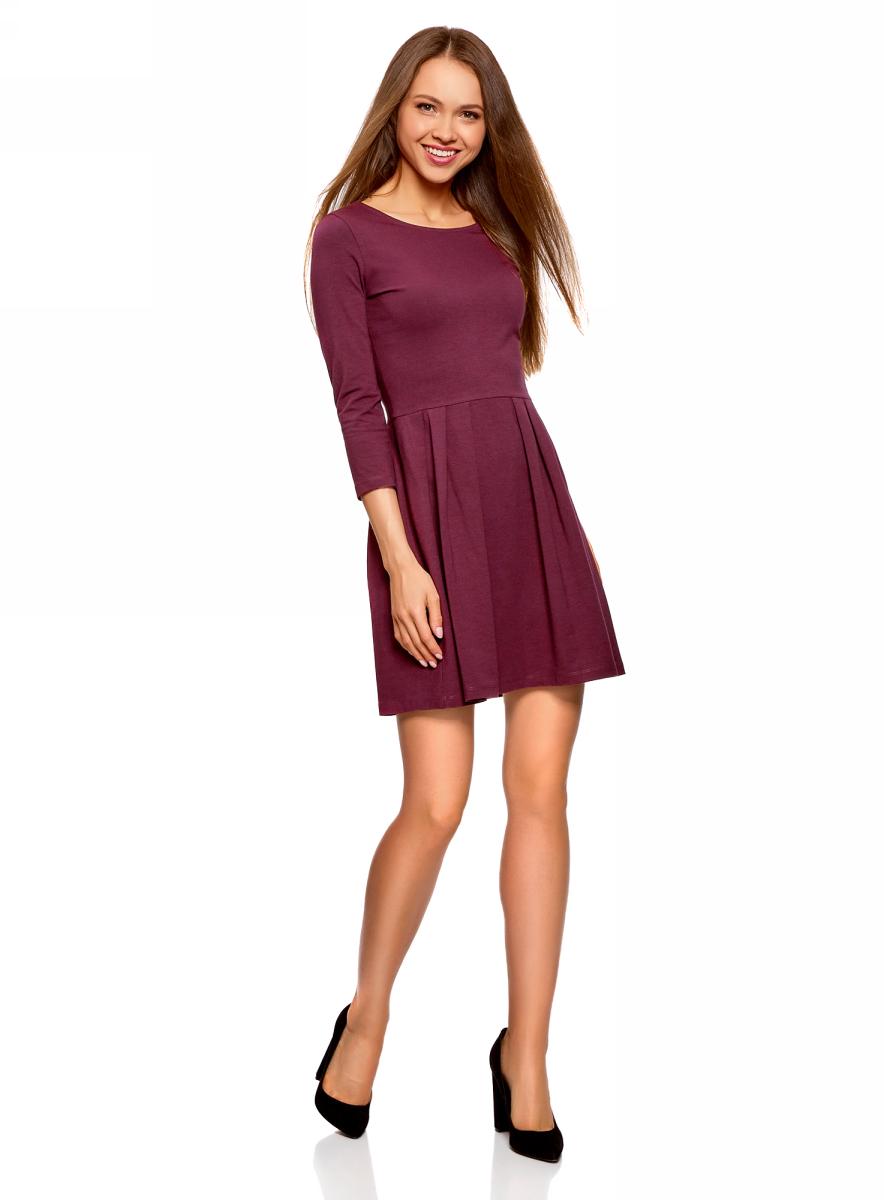 Платье oodji Ultra, цвет: сливовый. 14011005-3B/46148/8800N. Размер S (44)14011005-3B/46148/8800NТрикотажное платье от oodji выполнено из эластичного хлопкового трикотажа. Модель с рукавами 3/4 и круглым вырезом горловины дополнена отрезной юбкой со складками.