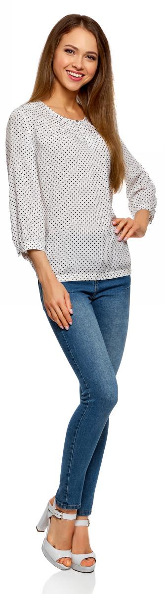 Блузка женская oodji Ultra, цвет: кремовый, черный. 11411166/24681/3029D. Размер 42-170 (48-170)11411166/24681/3029DСтильная блузка от oodji выполнена из натуральной вискозы. Модель с рукавами 3/4 и круглым вырезом горловины на груди имеет вырез-капельку на пуговице