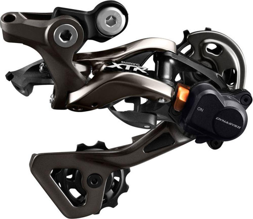 Переключатель задний Shimano XTR M9000, 11 скоростей, shadow RD+, SGSIRDM9000SGSЗадний переключатель профессионального уровня Shimano XTR M9000 на 11 скоростей с технологией Shadow+. Обновленный дизайн Shadow обеспечивает четкое и стабильное переключение. Простой в настройке, эффективный профиль зубьев. Карбоновая лапка.