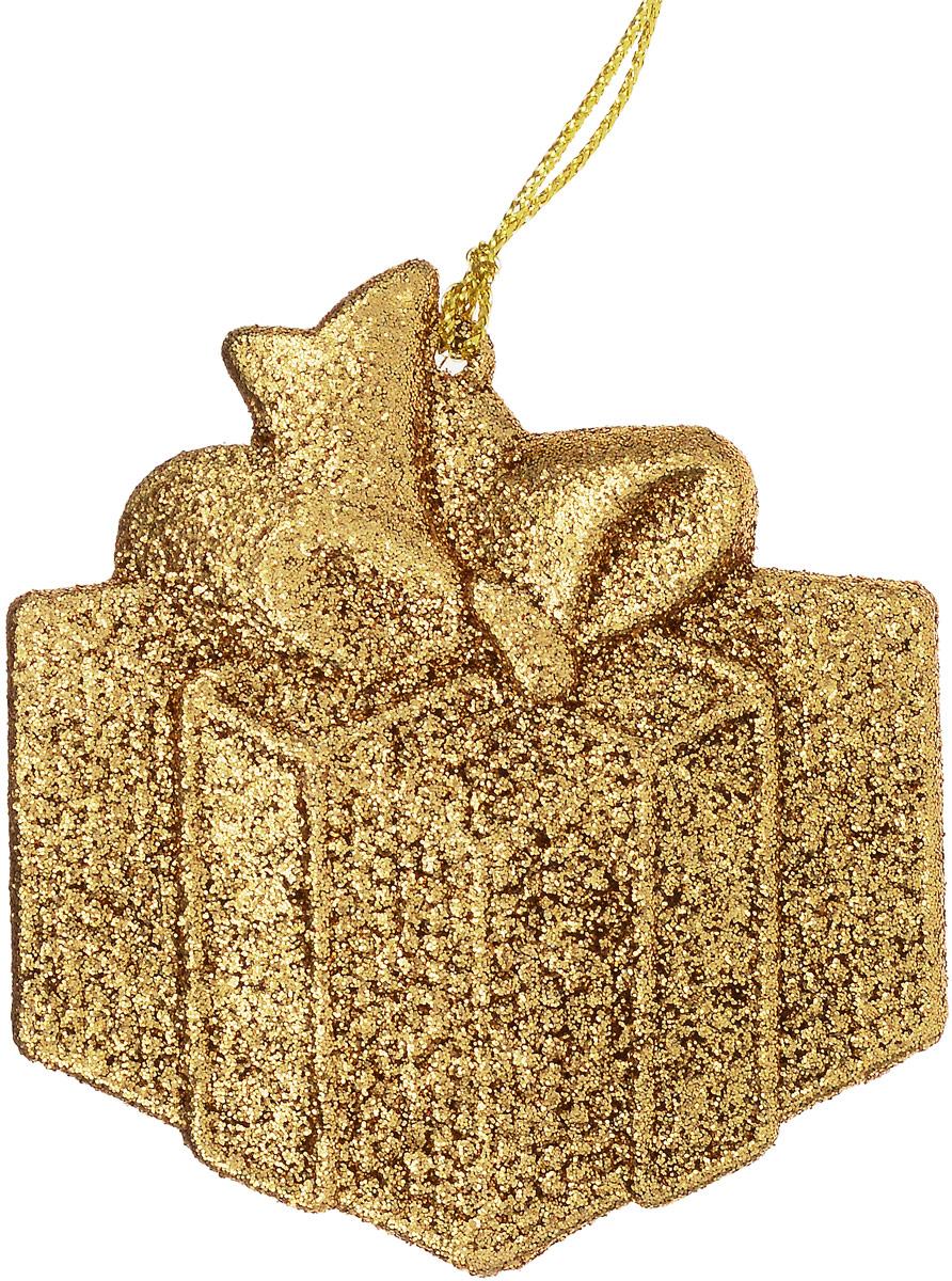 Украшение новогоднее подвесное Magic Time Подарок, цвет: золотой, 8 х 8,5 см75126Новогоднее украшение Magic Time Подарок отлично подойдет для декорации вашего дома и новогодней ели. Украшение выполнено из высококачественного пластика и оформлено блестками. Изделие оснащено текстильной петелькой, с помощью которой его можно повесить в любом понравившемся вам месте. Елочная игрушка - символ Нового года. Она несет в себе волшебство и красоту праздника. Создайте в своем доме атмосферу веселья и радости, украшая всей семьей новогоднюю елку нарядными игрушками, которые будут из года в год накапливать теплоту воспоминаний.