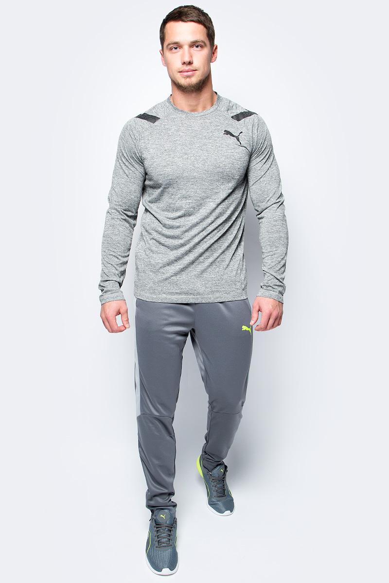 Брюки спортивные мужские Puma evoTRG Pant, цвет: серый. 65534003. Размер S (44/46)65534003Модель декорирована логотипом Puma, нанесенным на левую штанину методом термопечати. Она изготовлена с использованием высокофункциональной технологии DryCell, которая отводит влагу, поддерживает тело сухим и гарантирует комфорт во время активных тренировок и занятий спортом. Фирменные лампасы Puma выполнены из сетчатого материала. Пояс из эластичного материала снабжен затягивающимся шнуром. Такая конструкция пояса удачно дополняет эргономичный фасон в обтяжку по фигуре с зауженными штанинами. Два боковых карманы удобны и достаточно вместительны.