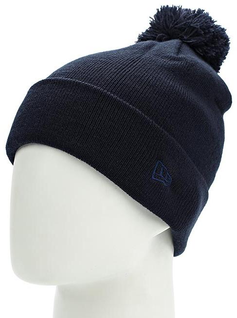 Шапка New Era Cuff Bobble, цвет: темно-синий. 11448345-NAV. Размер универсальный11448345-NAVТональная шапка с отворотом и помпоном оформлена вышитым логотипом сбоку New Era. Комфортная посадка благодаря тянущейся ткани.