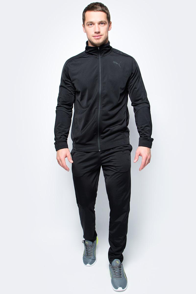 Спортивный костюм мужской Puma Techstripe Tricot Suit op, цвет: черный. 59263601. Размер XXL (52/54)59263601Спортивный костюм от Puma состоит из толстовки и брюк.Толстовка декорирована логотипом Puma, нанесенным методом пигментной печати. Функциональный фирменный покрой рукавов обеспечивает полную свободу движений и легкость сгибания и разгибания руки в локте. Боковые карманы вместительны и удобны. Пояс и манжеты посажены на подкладку из эластичного материала. Изделие имеет удобную стандартную посадку.Брюки декорированы логотипом Puma, нанесенным методом пигментной печати. Пояс из эластичного материала снабжен затягивающимся шнуром для лучшей посадки по фигуре. Изделие имеет удобную стандартную посадку, но при этом штанины с манжетами заужены, что в сочетании со вставками контрастного цвета придает модели оригинальный облик.
