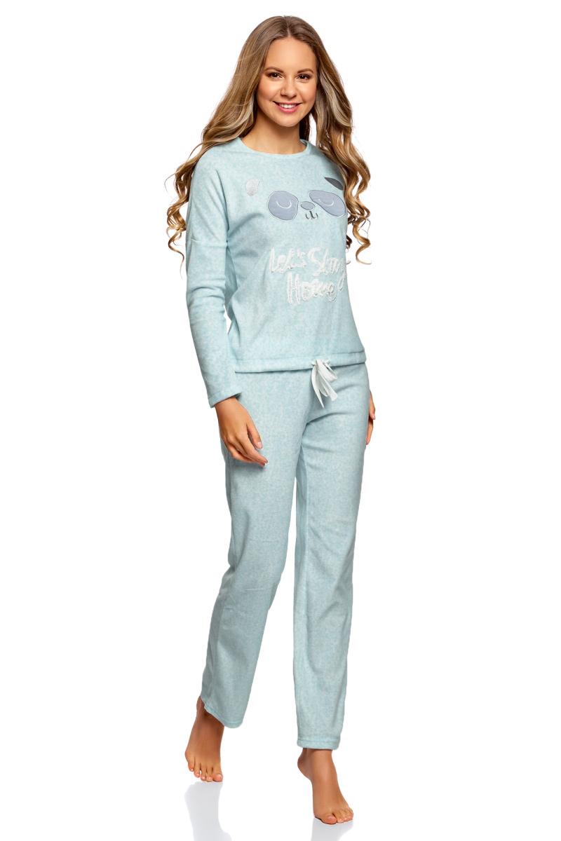 Лонгслив для дома женский oodji Underwear Ultra, цвет: голубой. 59811014/24336/7010O. Размер M (46)59811014/24336/7010OДомашний лонгслив от oodji свободного кроя с аппликацией на груди и завязками по низу. Модель с круглой горловиной и длинными рукавами. Забавная аппликация спереди придает модели домашний и уютный вид. Низ на кулиске со шнурком можно регулировать по ширине. Лонгслив из мягкого материала комфортный и мягкий на ощупь. Он подходит к любой фигуре и не стесняет движения. В уютном домашнем джемпере приятно расслабляться, спать или заниматься повседневными делами. Такой джемпер в сочетании с домашними брюками или шортами – отличная альтернатива халату. В нем вам будет приятно наслаждаться домашним теплом, общаться с близкими или принимать гостей. Домашний комфорт и хороший отдых в удобной и красивой одежде – залог прекрасного самочувствия и здоровья.
