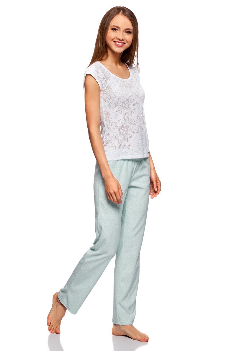 Брюки женские oodji Ultra, цвет: белый, голубой. 59807032/24336/1070O. Размер XS (42)59807032/24336/1070OКомфортные и симпатичные домашние брюки от oodji. Прямые штанины не стесняют движений во сне. Широкая поясная резинка сконструирована так, чтобы не сдавливать талию. В таких брюках вам всегда будет уютно и удобно. Брюки можно сочетать с разной одеждой. Они будут отлично смотреться в сочетании с футболками, топами, толстовками, домашними туниками и кардиганами. Абсолютно универсальная вещь. Вы можете использовать ее как нижнюю часть пижамы или просто как брюки, в которых вы будете ходить по дому. Прямой, слегка зауженный фасон этой вещи отлично подойдет для любой фигуры. Если вы цените комфорт и удобство в домашней одежде, но в то же время всегда хотите выглядеть стильно, эти брюки – настоящая находка, в которую вы обязательно влюбитесь.