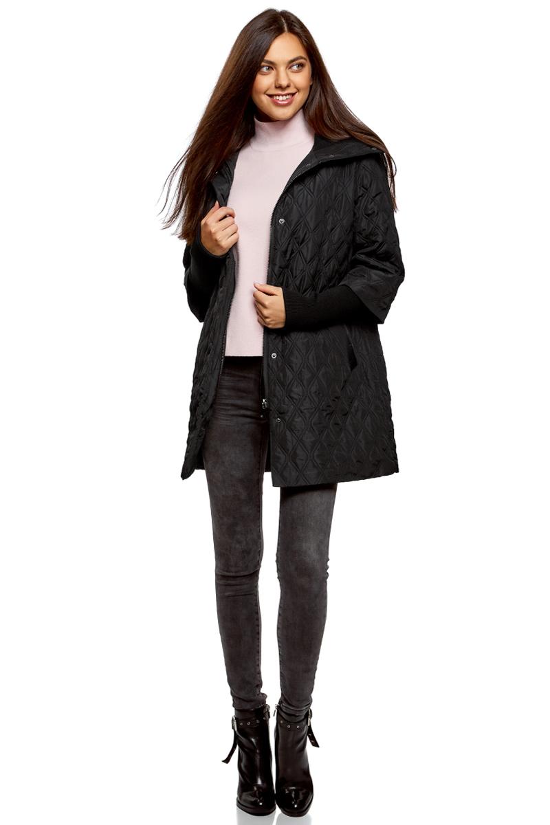 Пальто женское oodji Collection, цвет: черный. 28303004-1/47203/2900N. Размер 42-170 (48-170)28303004-1/47203/2900NСтеганое утепленное пальто от oodji прямого кроя. Модель выполнена из гладкого текстиля и утеплена синтепоном. Пальто застегивается молнию и имеет ветрозащитный клапан на кнопках, по бокам дополнено втачными карманами. Рукава имеют оригинальный крой.