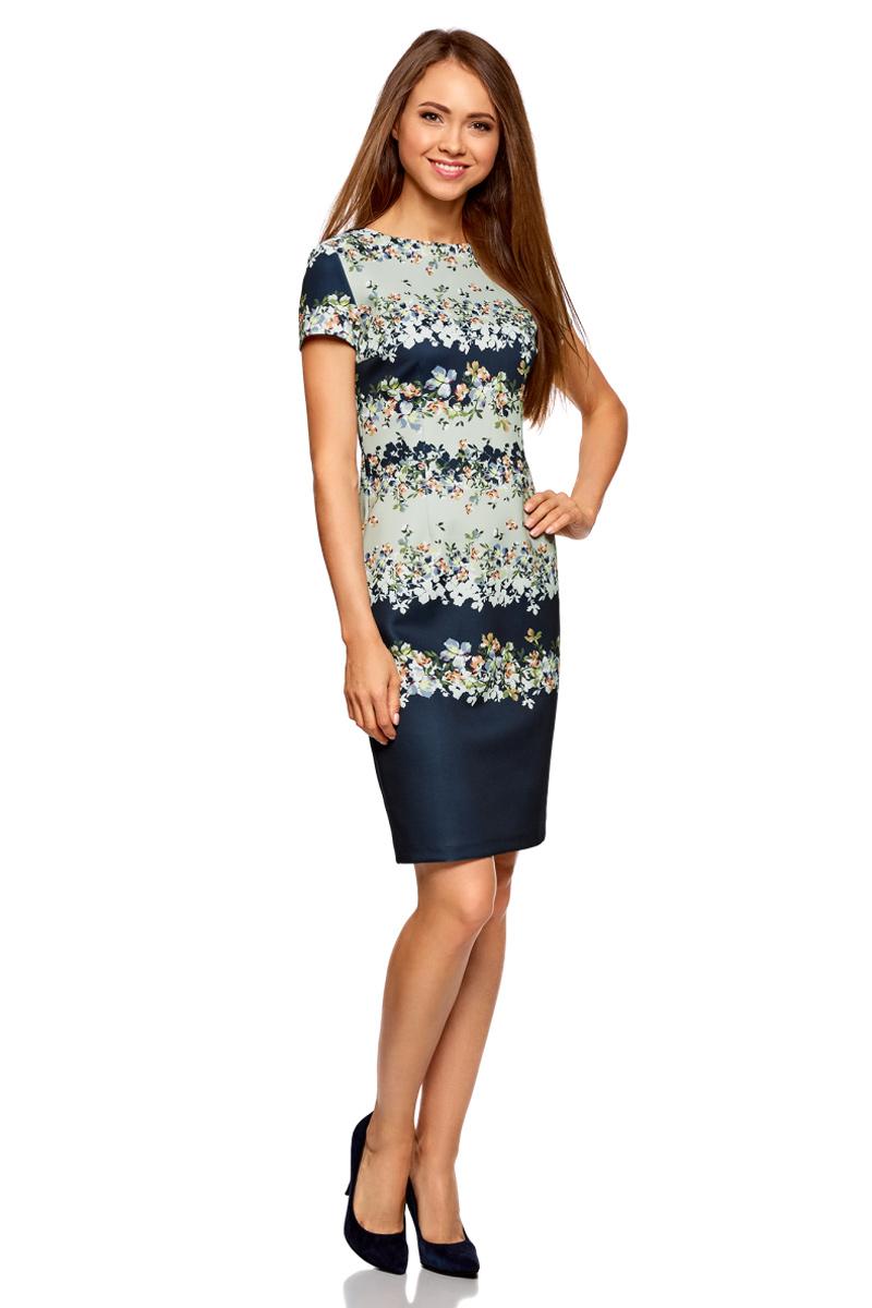 Платье oodji Collection, цвет: темно-синий, кремовый. 24011019-1/45344/7930F. Размер L (48)24011019-1/45344/7930FСтильное платье от oodji выполнено из высококачественного материала. Модель облегающего кроя с короткими рукавами и круглым вырезом горловины застегивается на потайную молнию, сзади дополнена шлицей.