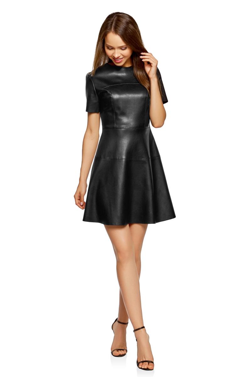 Платье oodji Ultra, цвет: черный. 18L00004-1/43578/2900N. Размер 42-170 (48-170)18L00004-1/43578/2900NСтильное платье от oodji выполнено из искусственной кожи. Приталенная модель с короткими рукавами и круглым вырезом горловины на спинке застегивается на потайную застежку-молнию.
