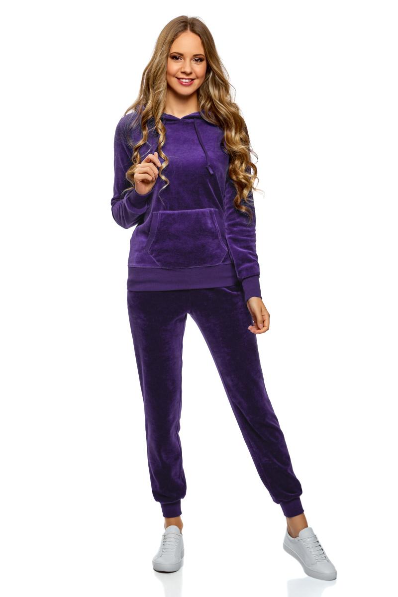 Брюки спортивные женские oodji Ultra, цвет: фиолетовый. 16701052B/47883/7501N. Размер XXS (40)16701052B/47883/7501NЖенские спортивные брюки oodji изготовлены из качественной смесовой ткани. Модель выполнена с широким эластичным поясом и завязками на талии. Низы брючин дополнены широкими манжетами.