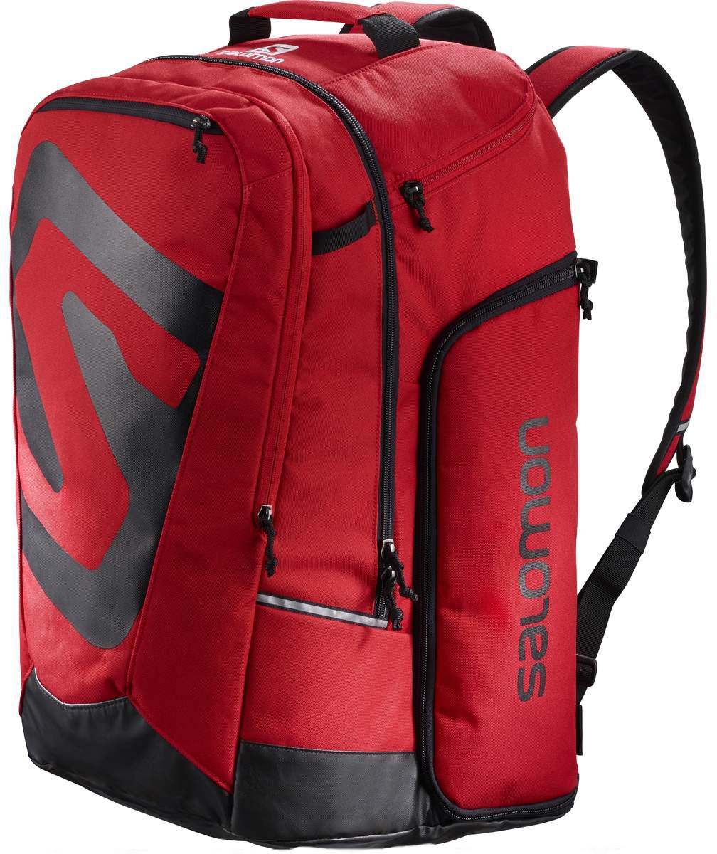 Рюкзак спортивный Salomon Extend Go-To-Snow Gear Bag, цвет: красный. L39754500L39754500Рюкзак Salomon Extend Go-To-Snow Gear Bag выполнен из высококачественного полиакрила. Рюкзак имеет одно вместительное отделение и закрывается на застежку-молнию. Рюкзак оснащен мягкими удобными лямками, длина которых регулируется с помощью пряжек. Изделие дополнено удобной ручкой для переноски или подвешивания. На внешней стороне расположены два втачных кармана на застежках-молниях. Боковые стенки оснащены многофункциональными карманами на молниях. Полюбившийся спортсменам рюкзак Salomon Extend Go-To-Snow Gear Bag идеально подходит для носки всего лыжного снаряжения. Модель удобно и надежно сохранит все необходимые для катания вещи, включая ботинки в двух раздельных отделениях, а также маски, перчатки и один-два слоя одежды. И при этом она поместится в ячейку для ручной клади.