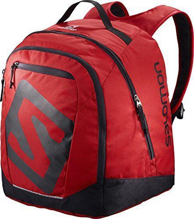 Рюкзак спортивный Salomon Original Gear Backpack, цвет: красный, черный. L39776800L39776800Рюкзак Salomon Original Gear Backpack выполнен из высококачественного полиакрила. Рюкзак имеет два вместительных отделения, которые закрываются на застежку-молнию. Рюкзак оснащен мягкими удобными лямками, длина которых регулируется с помощью пряжек. Изделие дополнено удобной ручкой для переноски или подвешивания. На внешней стороне расположен втачной карман на застежке-молнии. Полюбившийся спортсменам рюкзак Salomon Original Gear Backpack получил новый обтекаемый силуэт. Сбалансированное распределение нагрузки, простота в использовании, быстрый доступ в основное отделение, удобные набедренные карманы.Идеально подходит для носки всего лыжного снаряжения. Ботинки, защита, шлем и аксессуары поместятся в одном удобном рюкзаке, который не стеснит движение по склонам.