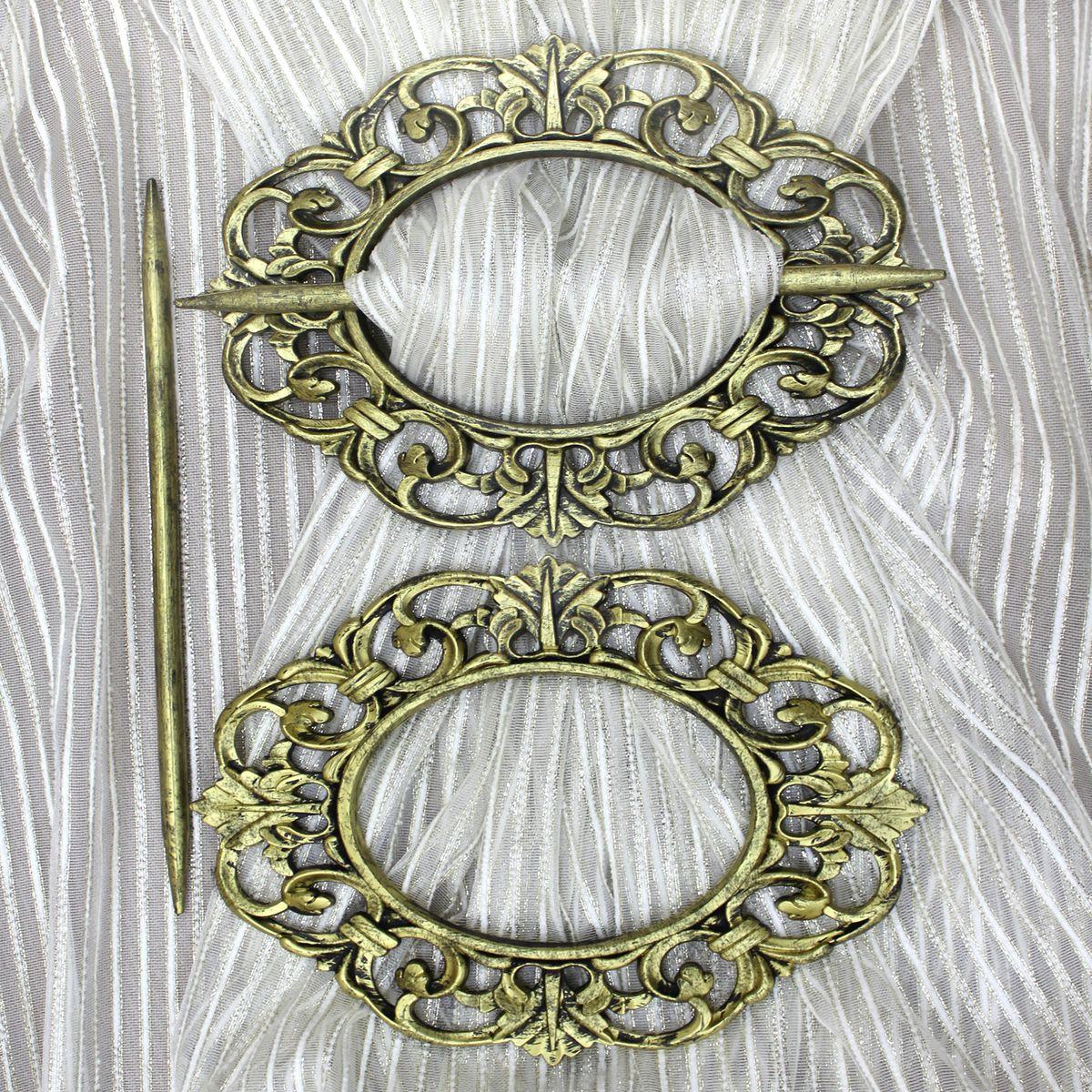 Заколка для штор TexRepublic Oval, цвет: золотистый, 2 шт. MI C2-1082009Заколка TexRepublic Oval, выполненная из высококачественного пластика, предназначена для фиксации штор или для формирования декоративных складок на ткани. С ее помощью можно зафиксировать шторы или скрепить их, придать им требуемое положение, сделать симметричные складки.Заколка для штор является универсальным изделием, которое превосходно подойдет для любых видов штор. Изделие придаст шторам восхитительный, стильный внешний вид и добавит уют в интерьер помещения. В комплекте 2 заколки.