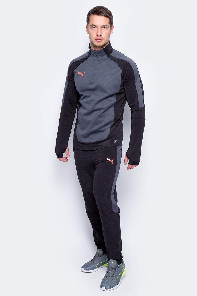 Брюки спортивные мужские Puma evoTRG Winter Pant, цвет: черный. 65542006. Размер L (48/50)65542006Модель изготовлена с использованием высокофункциональной технологии WarmCell, которая благодаря дышащим свойствам материала удерживает тепло и сохраняет оптимальную температуру вашего тела даже в холодную погоду. Модель декорирована логотипом Puma, нанесенным на левую штанину методом термопечати. Фирменные лампасы декорированы символикой Puma. Эргономичный покрой дополняется поясом из эластичного материала с затягивающимися шнурами. Также имеются два боковые карманы. Фасон в обтяжку по фигуре с зауженными штанинами очень элегантен.