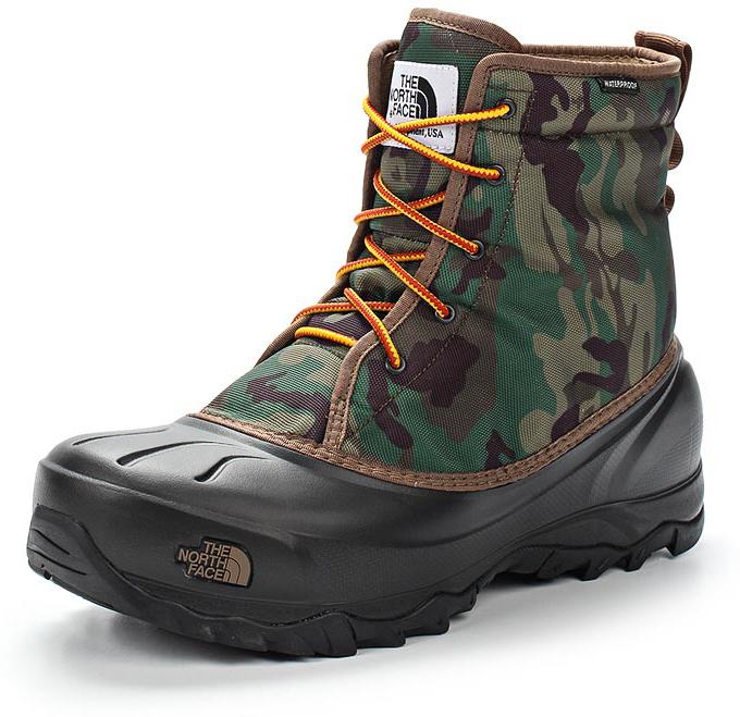 Ботинки мужские The North Face M Tsumoru Boot, цвет: черный, камуфляж. T93MKSYRL. Размер 7H (40)T93MKSYRLМужские водонепроницаемые ботинки Tsumoru Boot от The North Face с мягкой подкладкой из флиса. Гарантированно сохранят ноги в сухости во время зимних приключений. Мембрана HydroSeal защитит ваши ноги от замерзающих луж, в то время как материал PrimaLoft Silver Insulation Eco надежно сохранит тепло ног. Прочная резиновая подошва TNF Winter Grip обеспечивает надежное сцепление с непредсказуемой зимней поверхностью.