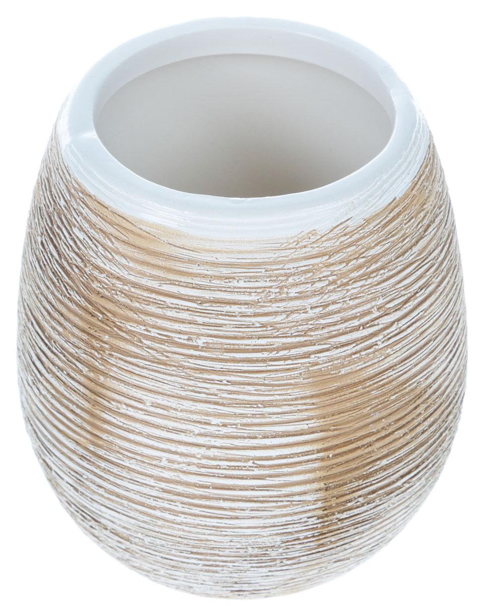 Стаканчик для ванной комнаты Duschy Bees Light351-01Оригинальный стаканчик Duschy Bees Light выполнен из керамики бежевого цвета, имеет рифленую поверхность. Стаканчик отличается легкостью и компактностью, при этом он устойчив. Такой стаканчик прекрасно подойдет для зубных щеток, пасты, расчесок и станет достойным дополнением интерьера ванной комнаты. Характеристики:Материал: керамика. Цвет: бежевый. Размер стаканчика: 9,5 см х 8 см х 8 см. Размер упаковки: 10 см х 9 см х 9 см. Артикул: 351-01.