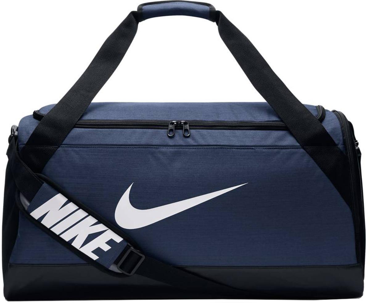Сумка спортивная Nike Brasilia Training Duffel Bag, цвет: синий. BA5334-410BA5334-410Сумка-дафл Nike Brasilia (средний размер) выполнена из невероятно прочной ткани для переноски спортивной экипировки. Внутренние карманы помогают держать вещи в порядке, а отделение для обуви позволяет хранить влажную экипировку отдельно от сухой.Прочная водонепроницаемая ткань дна защищает экипировку от влаги.Вместительное и универсальное основное отделение.Вентилируемое отделение для хранения влажной/сухой обуви.Водонепроницаемый полиэстер высокой плотности отличается прочностью.Универсальное вместительное основное отделение оснащено двойной молнией.Двойные ручки можно соединить вместе для удобного ношения.Мягкая плечевая лямка снимается и регулируется для комфортного .