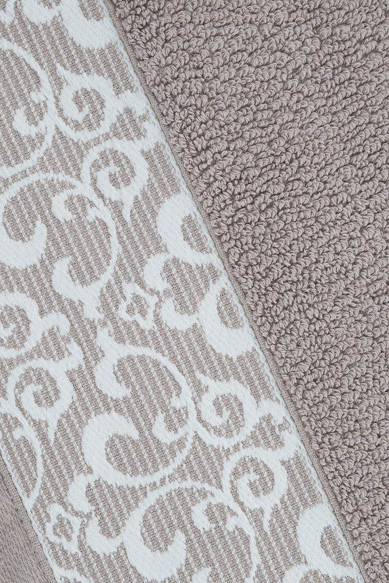"""Банное полотенце Issimo Home """"Verda"""" выполнено из натуральной махровой ткани (100% хлопок). Изделие отлично впитывает влагу, быстро сохнет и не теряет форму даже после многократных стирок.Рекомендации по уходу:- режим стирки при 40°C,- допускается обычная химчистка,- отбеливание запрещено,- глажка при температуре подошвы утюга до 110°С,- барабанный отжим запрещен.Размер полотенца: 70 x 140 см."""