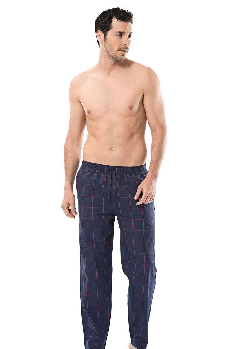 Брюки для дома мужские Cacharel, цвет: темно-синий. 2145. Размер XXL (52/54)2145Брюки для дома мужские Cacharel выполнены из эластичного хлопка. Модель на резинке дополнена регулируемым шнурком.