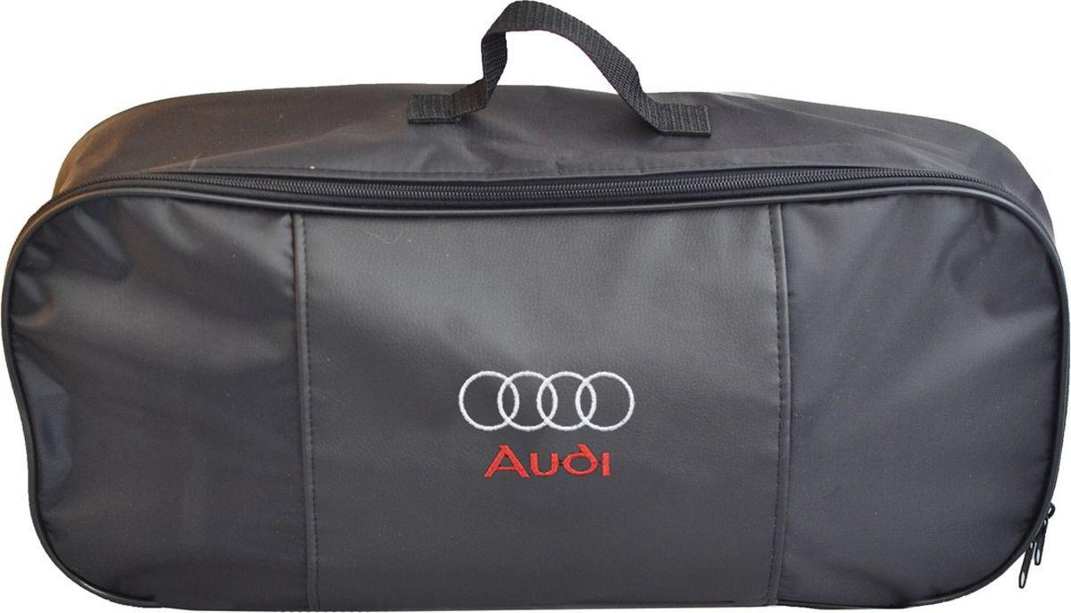 Автосумка Auto Premium Audi, для аварийного набора, 47 х 21 х 13 см67301Сумка Auto Premium Audi для набора техосмотра выполнена из прочного и износоустойчивого материла (ПВХ 600) со вставкой из экокожи и вышивкой. Она идеально подходит для хранения аварийного набора, например, огнетушителя, знака аварийной остановки, буксировочного троса и много другого.