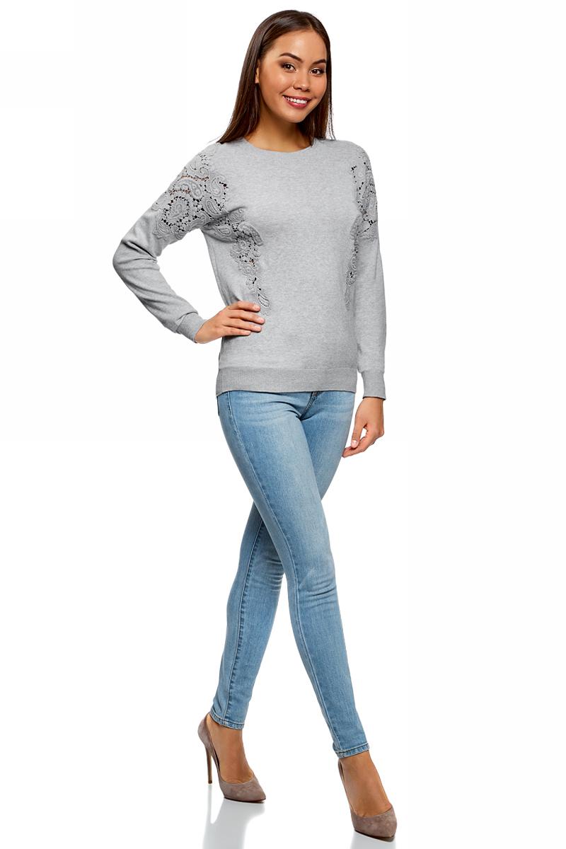Джемпер женский oodji Ultra, цвет: серый. 63812619/47371/2300M. Размер L (48)63812619/47371/2300MДжемпер от oodji выполнен из пряжи сложного состава. Модель с длинными рукавами и круглым вырезом горловины декорирована кружевными вставками.