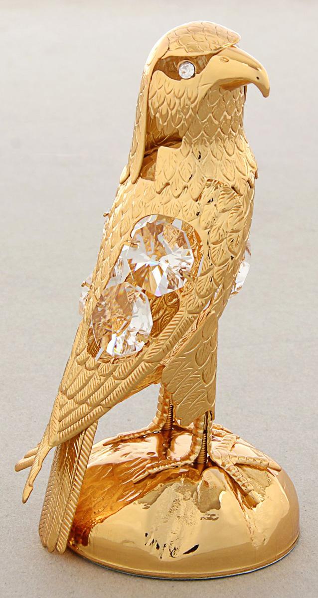Миниатюра Swarovski Elements Орел, с кристаллами Сваровски, 5 х 6 х 11 см1196115Сувенирный орёл станет идеальным подарком близкому человеку и всем любителям эксклюзивных вещей ручной работы. Это универсальный символ, воплощающий мощь, скорость и величие. Орла дарят для вдохновения, победы, власти и обретения силы. Горделивый спокойный орёл поможет всегда быть на высоте положения.Сувенир украшен стразами Swarovski, которые были признаны специалистами лучшей имитацией бриллиантов. Свет, попадая на кристаллы Swarovski, разбивается на миллион радужных лучей. Это зрелище, бесспорно, оставляет яркое впечатление!