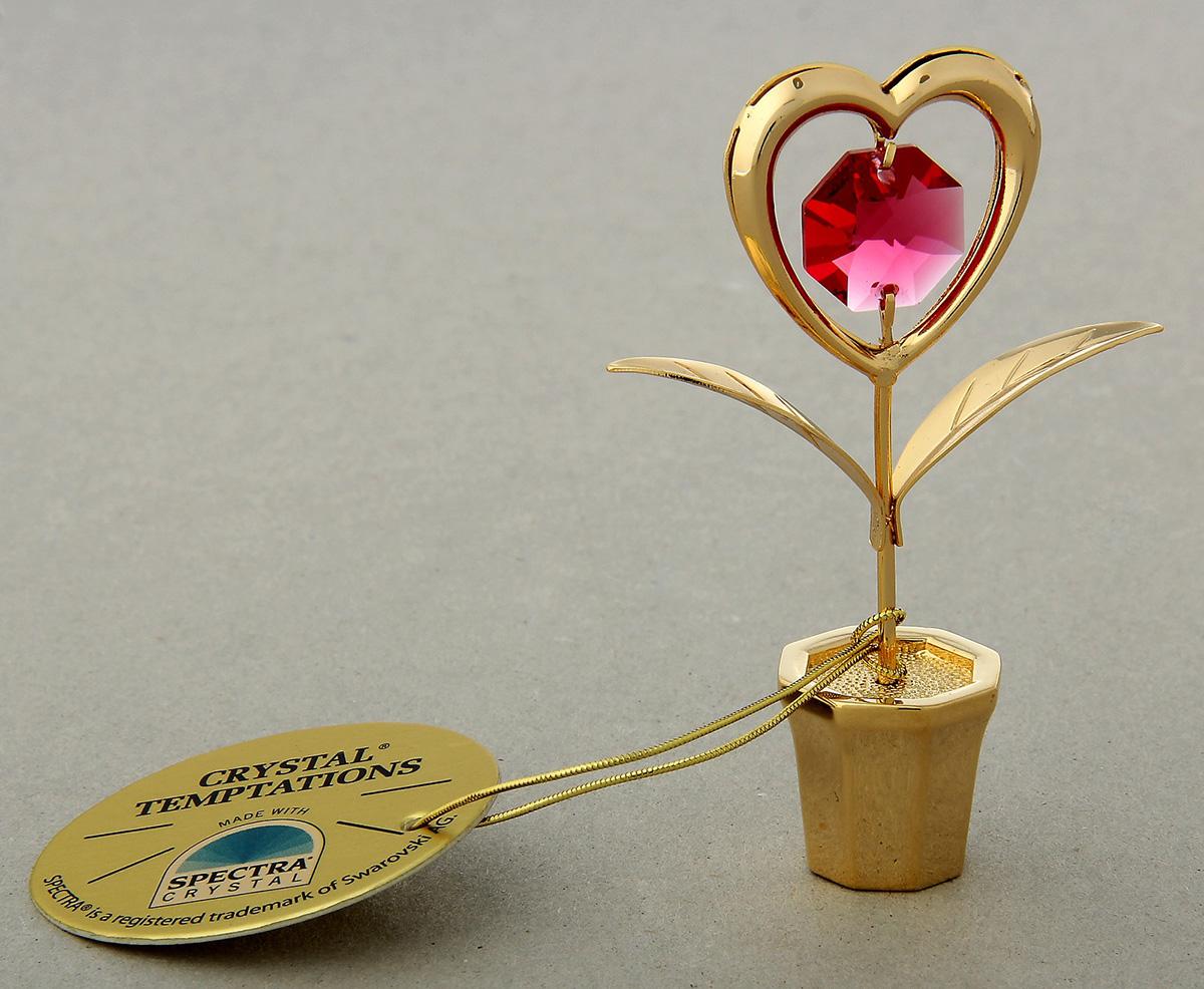Миниатюра Swarovski Elements Цветочек в виде сердца, с кристаллом Сваровски, 7 х 3 х 6 см147410Сувенирное сердце станет идеальным подарком близкому человеку и всем любителям эксклюзивных вещей ручной работы. Символ сердца связан с образом взаимной любви. Именно поэтому такой подарок можно подарить, чтобы выразить свои чувства любимому человеку.Сувенир украшен стразами Swarovski, которые были признаны специалистами лучшей имитацией бриллиантов. Свет, попадая на кристаллы Swarovski, разбивается на миллион радужных лучей. Это зрелище, бесспорно, оставляет яркое впечатление!